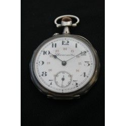 Antiguo reloj de bolsillo Frances , de carga manual , funcionando