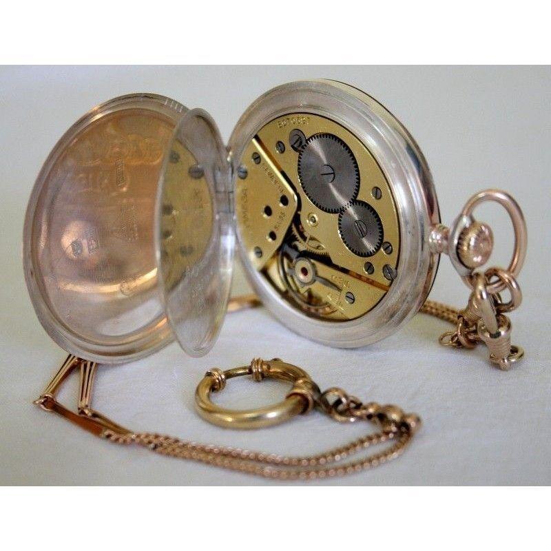 Elegante reloj de plata omega con cadena funcionando - Reloj de cadena ...