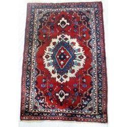 Antigua Alfombra persa de lana.