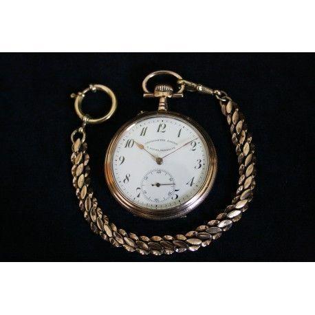 Elegante reloj de bolsillo francés con cuerda manual de los años 1900.