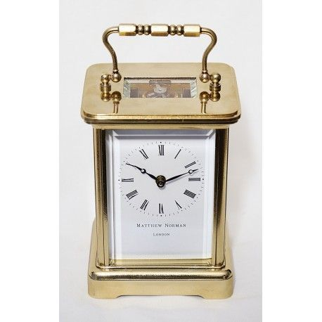 Antiguo reloj de carruaje, de máquina suiza con cuerda manual importado a Londres por la casa Matthew Norman London.