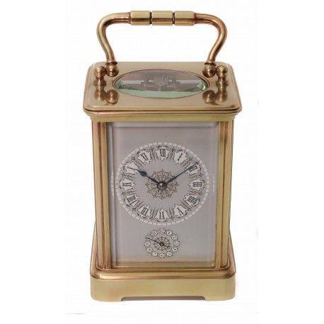 Antiguo reloj de carruaje, cuerda manual ,con soneria, de origen ingles.