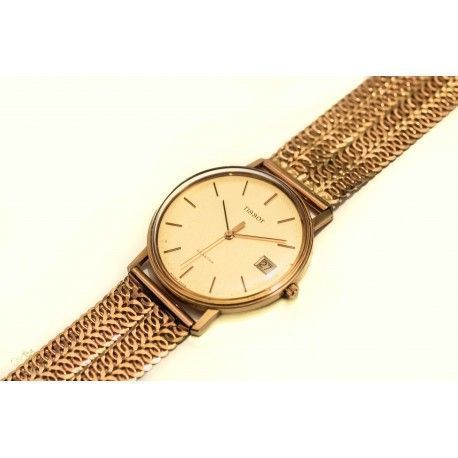 682fe6e94147 Espectacular reloj de oro Tissot Seastar