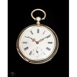 Antiguo reloj de bolsillo de cuerda con llave y funcionando perfectamente