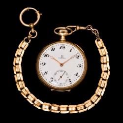 Antiguo reloj de bolsillo, de la casa Omega, finales de los años 1900 y funcionando,caja de oro.