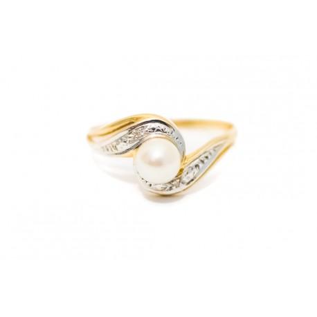 Antiguo anillo de oro de 18 K con una perla, combinado con oro blanco
