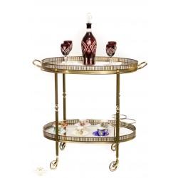 Antigua mesa camarera, con ruedas, en bronce macizo, de origen francés.