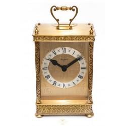 Clásico reloj de carruaje en bronce ,de origen ingles.