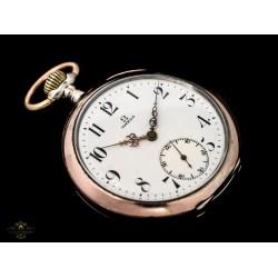 Antiguo reloj de bolsillo, de origen suizo plata maciza de la marca Omega, funcionando