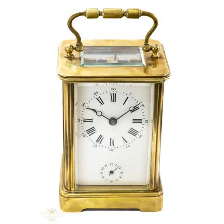 Antiguo reloj de carruaje, con sistema despertador, de cuerda manual ,de origen ingles.