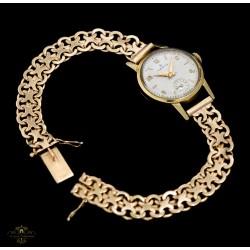 Espectacular reloj de oro para mujer, de cuerda manual de la marca ZENITH, funcionando perfectamente.