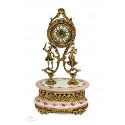Antiguo reloj de sobremesa, de estilo rococó , combinado porcelana y bronce, funcionando