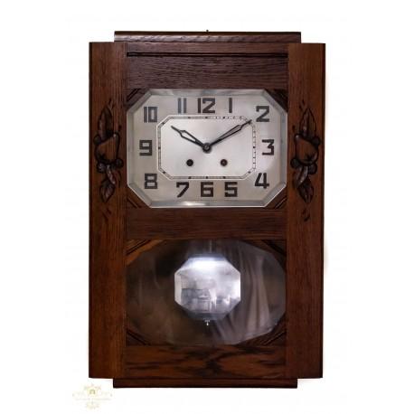 Antiguo reloj de pared origen francés, y funcionando.