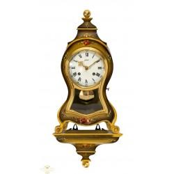 Antiguo reloj de pared con consola de origen suizo Lo Cassel, y funcionando.