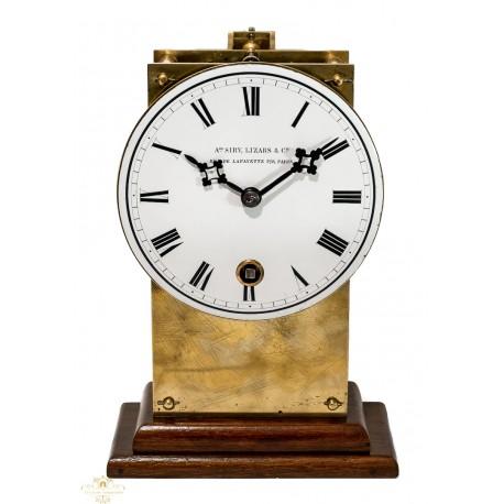 Antiguo reloj de sobremesa en bronce y fundición