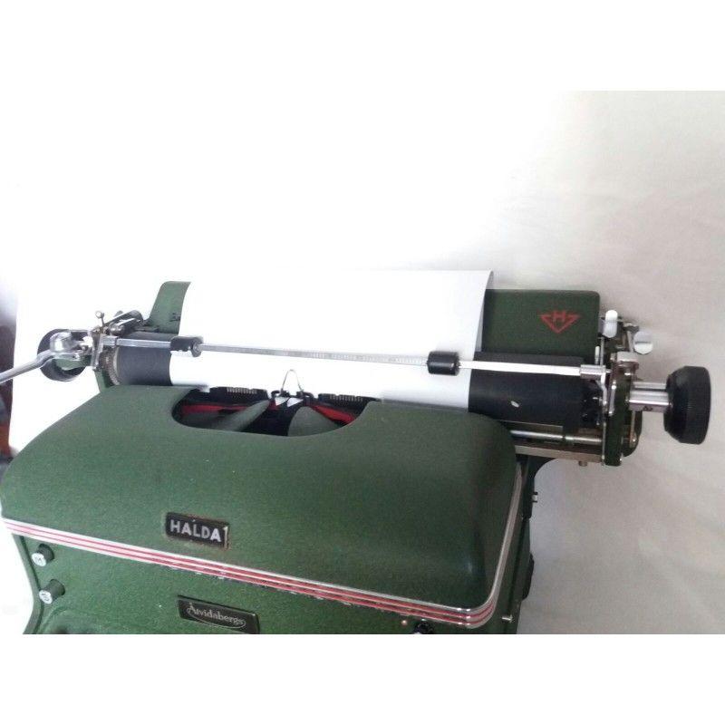 Antigua maquina de escribir de la marca halda for Antiguedades de oficina
