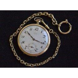 Antiguo reloj de bolsillo, de carga manual , funcionando
